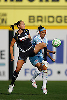Brittany Bock (11) of the Los Angeles Sol and Natasha Kai (6) of Sky Blue FC. The Los Angeles Sol defeated Sky Blue FC 2-0 during a Women's Professional Soccer match at TD Bank Ballpark in Bridgewater, NJ, on April 5, 2009. Photo by Howard C. Smith/isiphotos.com