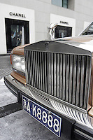 A Chanel shop & a Rolls Royce are seen in the Peninsula Palace Hotel in Beijing, China..