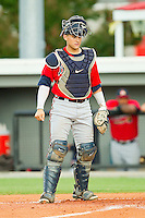 Catcher Nick DeSantiago #18 of the Danville Braves on defense against the Burlington Royals at Burlington Athletic Park on August 14, 2011 in Burlington, North Carolina.  The Braves defeated the Royals 10-2 in a game called by rain in the bottom of the 8th inning.   (Brian Westerholt / Four Seam Images)