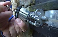 Locking a security padlock.