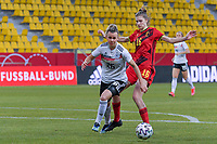 Belgian Marie Minnaert (16) and German Lena Lattwein (26) pictured during a friendly female soccer game between the national teams of Germany and  Belgium , called the Red Flames  in a pre - bid tournament called Three Nations One Goal with the national teams from Belgium , The Netherlands and Germany towards a bid for the hosting of the 2027 FIFA Women's World Cup , on Sunday 21 st of February 2021  in Aachen , Germany . PHOTO SPORTPIX.BE   SPP   STIJN AUDOOREN
