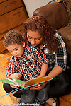 Young mother reading to 2 year old son