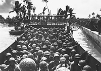 """""""Paradise Lost"""" by Japs at Kwajalein.  Palm-studded Carlos Island, a South Pacific paradise in the Marshalls, falls to American invasion forces driving ashore in Coast Guard-manned landing craft.  February 1944.  Morris A. Lucia.  (Coast Guard)<br /> Exact Date Shot Unknown<br /> NARA FILE #:  026-G-3289<br /> WAR & CONFLICT BOOK #:  1166"""