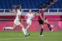 SAITAMA, JAPAN - JULY 24: Carli Lloyd #10 of the USWNT controls the ball during a game between New Zealand and USWNT at Saitama Stadium on July 24, 2021 in Saitama, Japan.