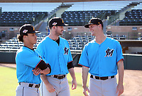 Bryson Brigman, Chad Smith and Kyle Keller model the new Miami Marlins uniforms prior to the 2018 Arizona Fall League championship game won by the Javelinas, 3-2 in 10 innings, over the Salt River Rafters at Scottsdale Stadium on November 17, 2018 in Scottsdale, Arizona. (Bill Mitchell)