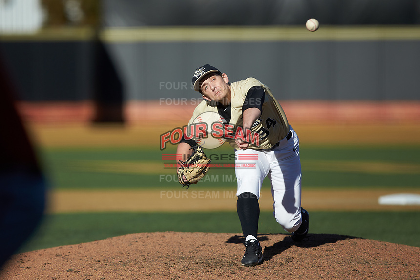 Wake Forest Demon Deacons relief pitcher Bobby Hearn (34) delivers a pitch to the plate against the Gardner-Webb Runnin' Bulldogs at David F. Couch Ballpark on February 18, 2018 in  Winston-Salem, North Carolina. The Demon Deacons defeated the Runnin' Bulldogs 8-4 in game one of a double-header.  (Brian Westerholt/Four Seam Images)