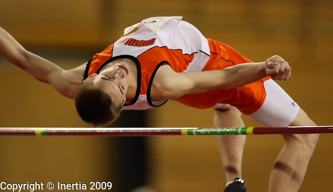 VERMILLION, SD - MARCH 30:  Jordan Willeson of Washington watches the bar during the boys high jump at the 2009 Dan Lennon Track and Field Invitational at the DakotaDome in Vermillion. (Photo by Dave Eggen/Inertia)