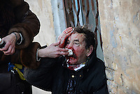 An elder protester has been injured and is heavily bleeding from his head and face.  Kiev, Ukraine