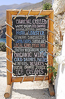 Traditional menu black-board in tavern in Chora Sfakion, Crete, Greece