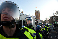 A line of police protect the Houses of Parliament during a student demonstration in Westminster, central London on the day the government passed a bill to increase university tuition fees.