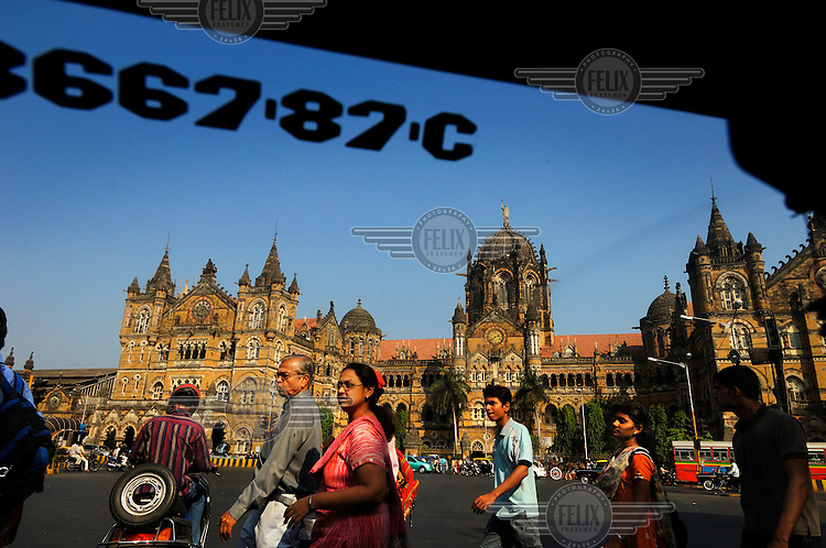 Pedestrians in front of Chhatrapati Shivaji Terminus, the city's main railway station, which was formerly known as Victoria Terminus (VT) and is better known as CST or Bombay VT.