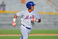 Kingsport Mets left fielder Victor Cruzado #17 runs to first during a game against the Elizabethton Twins at Hunter Wright Stadium on June 29, 2013 in Kingsport, Tennessee. The Mets won the game 5-4. (Tony Farlow/Four Seam Images)