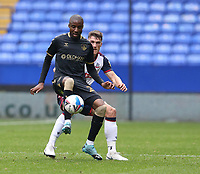 Oldham Athletic's Dylan Bahamboula shields the ball from Bolton Wanderers' Ryan Delaney<br /> <br /> Photographer Stephen White/CameraSport<br /> <br /> The EFL Sky Bet League Two - Bolton Wanderers v Oldham Athletic - Saturday 17th October 2020 - University of Bolton Stadium - Bolton<br /> <br /> World Copyright © 2020 CameraSport. All rights reserved. 43 Linden Ave. Countesthorpe. Leicester. England. LE8 5PG - Tel: +44 (0) 116 277 4147 - admin@camerasport.com - www.camerasport.com