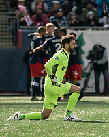 FOXBOROUGH, MA - MARCH 7: Kecceth Kronholm #18 of Chicago Fire reacts to the goal with the New England players celebrating in the background during a game between Chicago Fire and New England Revolution at Gillette Stadium on March 7, 2020 in Foxborough, Massachusetts.
