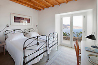 cycladic bedroom with two beds