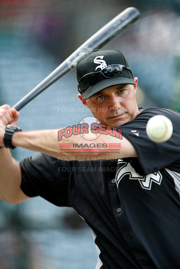Chicago White Sox coach Joe McEwing #47 hits fungos before a game against the Los Angeles Angels at Angel Stadium on September 22, 2012 in Anaheim, California. Los Angeles defeated Chicago 4-2. (Larry Goren/Four Seam Images)