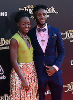 Lupita Nyong'o + brother Peter @ the premiere of 'The Jungle Book' held @ El Capitan theatre.<br /> April 4, 2016