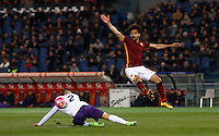 Calcio, Serie A: Roma vs Fiorentina. Roma, stadio Olimpico, 4 marzo 2016.<br /> Fiorentina's Facundo Roncaglia, left, and Roma's Mohamed Salah fight for the ball during the Italian Serie A football match between Roma and Fiorentina at Rome's Olympic stadium, 4 March 2016.<br /> UPDATE IMAGES PRESS/Riccardo De Luca