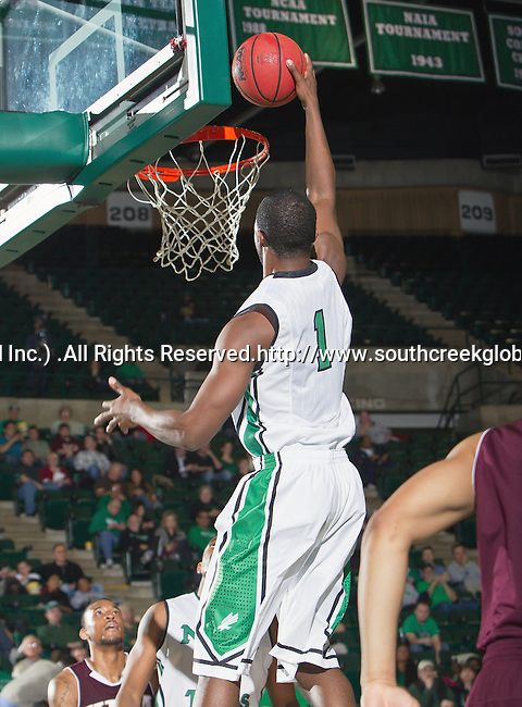 North Texas Mean Green forward Jacob Holmen (1) in action during the game between the Louisiana Monroe Warhawks and the University of North Texas Mean Green at the North Texas Coliseum,the Super Pit, in Denton, Texas. UNT defeats ULM 86 to 51...