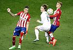 Atletico de Madrid's Jose Maria Gimenez (l) and Antoine Griezmann (r) and Real Madrid's Luka Modric during La Liga match. October 4,2015. (ALTERPHOTOS/Acero)