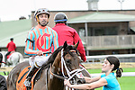 Conquest Daddyo(7) with Jockey Patrick Husbands aboard makes his way to the winners circle after running to victory at the Summer Stakes at Woodbine Race Course in Toronto, Canada on September 12, 2015.