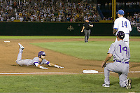TCU's Taylor Featherston slides into third base after hitting a bases loaded triple in Game 6 of the NCAA Division One Men's College World Series on Monday June 21st, 2010 at Johnny Rosenblatt Stadium in Omaha, Nebraska.  (Photo by Andrew Woolley / Four Seam Images)
