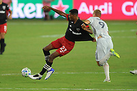 WASHINGTON, DC - AUGUST 25: Donovan Pines #23 of D.C. United battles for the ball with Adam Buska #9 of New England Revolution during a game between New England Revolution and D.C. United at Audi Field on August 25, 2020 in Washington, DC.