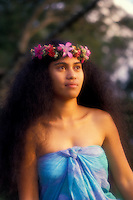 Beautiful young woman wearing a haku lei and aloha wear