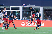 FOXBOROUGH, MA - JULY 25: Christian Mafla #32 of New England Revolution heads the ball during a game between CF Montreal and New England Revolution at Gillette Stadium on July 25, 2021 in Foxborough, Massachusetts.