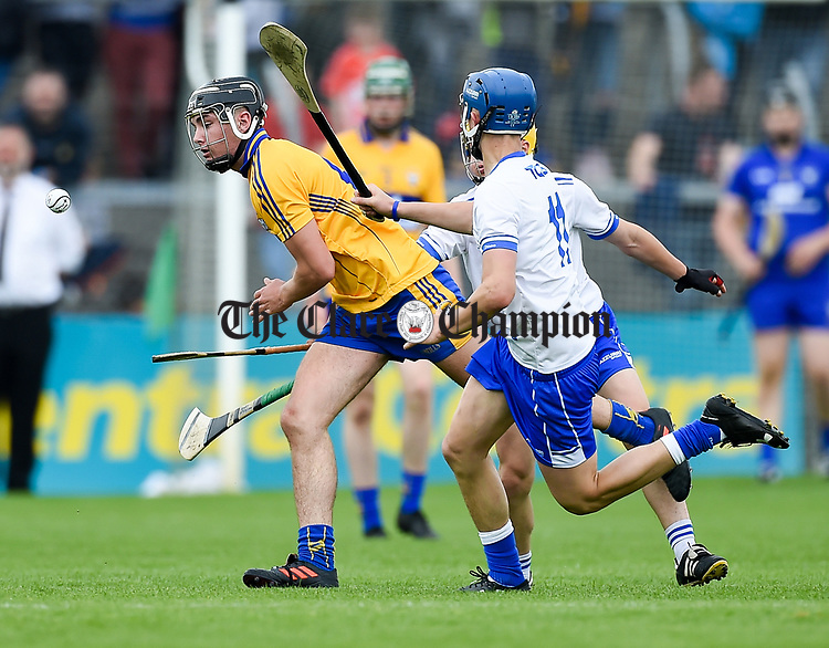 Dylan Mc Mahon of Clare  in action against Paddy Leevy of Waterford during their Munster  championship round robin game at Cusack Park Photograph by John Kelly.