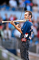 30 September 2009: Violinist Glenn Donnellan a musician with the National Symphony Orchestra, plays on a custom-made Louisville Slugger electric violin-bat at a game between the Washington Nationals and the New York Mets at Nationals Park in Washington, DC. The Nationals rallied in the bottom of the 9th inning on a Justin Maxwell walk-off Grand Slam to win 7-4 and sweep the Mets' 3-game series, capping the Nationals' 2009 home season. Mandatory Credit: Ed Wolfstein Photo