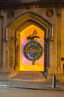 "UK, England, Cambridge.  Corpus Clock, Corpus Christi College, under Nightime Illumination.  ""Chronophage"" on top, ""eater of time"", a giant grasshopper.  Dedicated 2008."