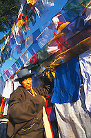 Tibetans tying prayer flags druing Losar, Tibetan New Year.