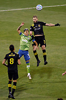 COLUMBUS, OH - DECEMBER 12: Raul Ruidiaz #9 of Seattle Sounders FC battles for the ball with Josh Williams #3 of Columbus Crew during a game between Seattle Sounders FC and Columbus Crew at MAPFRE Stadium on December 12, 2020 in Columbus, Ohio.