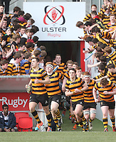 2015 ULSTER SCHOOLS CUP FINAL | Tuesday 17th March 2015<br /> <br /> Lewis McNamara leads RBAI out during the 2015 Ulster Schools Cup Final between RBAI and Wallace High School at the Kingspan Stadium, Ravenhill Park, Belfast, Count Down, Northern Ireland.<br /> <br /> Picture credit: John Dickson / DICKSONDIGITAL