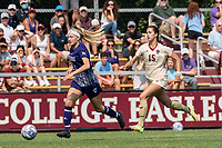 NEWTON, MA - SEPTEMBER 12: Melanie Lytle #21 of Holy Cross brings the ball forward as Samantha Agresti #15 of Boston College closes during a game between Holy Cross and Boston College at Newton Campus Soccer Field on September 12, 2021 in Newton, Massachusetts.