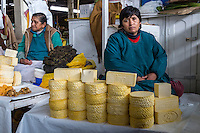 Peru, Cusco, San Pedro Market.  Woman Selling Cheeese.