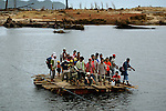 Displaced villagers from Lhong cross a river to a camp in the Aceh District of Indonesia in January 9, 2005.  100,000 are estimated to be dead and hundreds of thousands are left homeless in Indonesia because of the tsunami.  (photo by Khampha Bouaphanh)