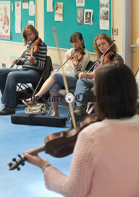Students attend one of the workshops during the Feakle International Festival of Traditional Music on Friday. Photograph by Declan Monaghan