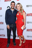 HOLLYWOOD, CA - JUNE 15: Rich Orosco and Julie Benz arrive at the premiere screening of Showtime's 'Dexter' Season 8 at Milk Studios on June 15, 2013 in Hollywood, California. (Photo by Celebrity Monitor)