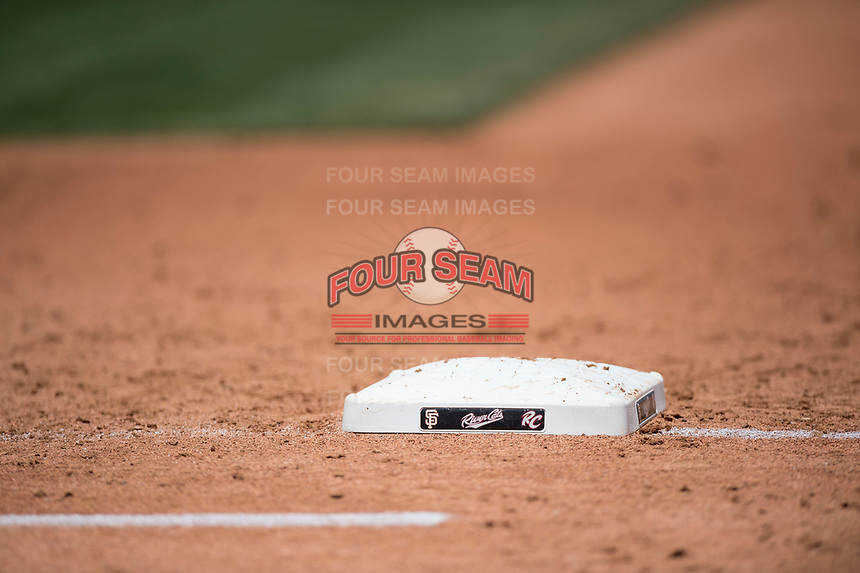 First base dons the Sacramento RiverCats logo during a Pacific Coast League game between the Tacoma Rainiers and the Sacramento RiverCats at Raley Field on May 15, 2018 in Sacramento, California. Tacoma defeated Sacramento 8-5. (Zachary Lucy/Four Seam Images)