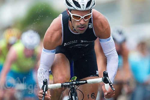 17 SEP 2011 - LA BAULE, FRA - Bruno Pais (Les Sables Vendee Tri) works on the bike during the final round of the men's French Grand Prix Series at the Triathlon Audencia in La Baule, France .(PHOTO (C) NIGEL FARROW)