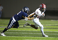 Chris Cortez (80) of Springdale tries to avoid tackle of Lane Reiter (1) of Springdale Har-ber on Friday, Oct. 8, 2021, during the first half of play at Wildcat Stadium in Springdale. Visit nwaonline.com/211009Daily/ for today's photo gallery.<br /> (Special to the NWA Democrat-Gazette/David Beach)