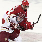 Ryan Fitzgerald (BC - 19), Jedd Soleway (Wisconsin - 22) - The Boston College Eagles defeated the visiting University of Wisconsin Badgers 9-2 on Friday, October 18, 2013, at Kelley Rink in Conte Forum in Chestnut Hill, Massachusetts.