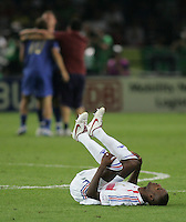 French defender (3) Eric Abidal lies on his back at midfield after the game.  Italy defeated France on penalty kicks after leaving the score tied, 1-1, in regulation time in the FIFA World Cup final match at Olympic Stadium in Berlin, Germany, July 9, 2006.