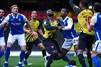 20th March 2021; Vicarage Road, Watford, Hertfordshire, England; English Football League Championship Football, Watford versus Birmingham City; Isaac Success of Watford has his shirt tugged in the penalty area.