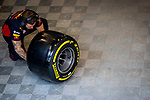 Aston Martin Red Bull Racing Honda mechanic checks a tire during the tests for the new Formula One Grand Prix season at the Circuit de Catalunya in Montmelo, Barcelona. February 19, 2020 (ALTERPHOTOS/Javier Martínez de la Puente)