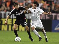 30 October,  2004.  MetroStars midfielder Gilberto Flores (25) tries to take the ball away from DC United's Dema Kovalenko (21)  during the 2004 MLS playoffs at RFK Stadium in Washington, DC.