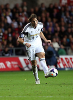 Saturday 28 September 2013<br /> Pictured:  Michu of Swansea shoots off target.<br /> Re: Barclay's Premier League, Swansea City FC v Arsenal at the Liberty Stadium, south Wales.