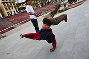 """Youths hang around the city's main clock tower area in downtown Thimphu, Bhutan. Television and the internet have been accessible only since 1999, and were introduced despite widespread fears that their """"controversial"""" content such as fashion shows, western music, wrestling, and pornography, could destroy the kingdom's traditional way of life based on unique Buddhist principles. Sanjit Das/Panos"""
